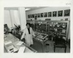 Inez Moore Parker standing in the archives
