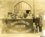 Kappa Alpha Psi Omicron of Columbia University standing outside with a banner